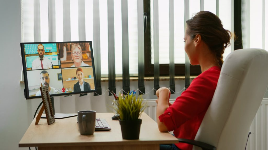 Woman talking with colleagues on webcam