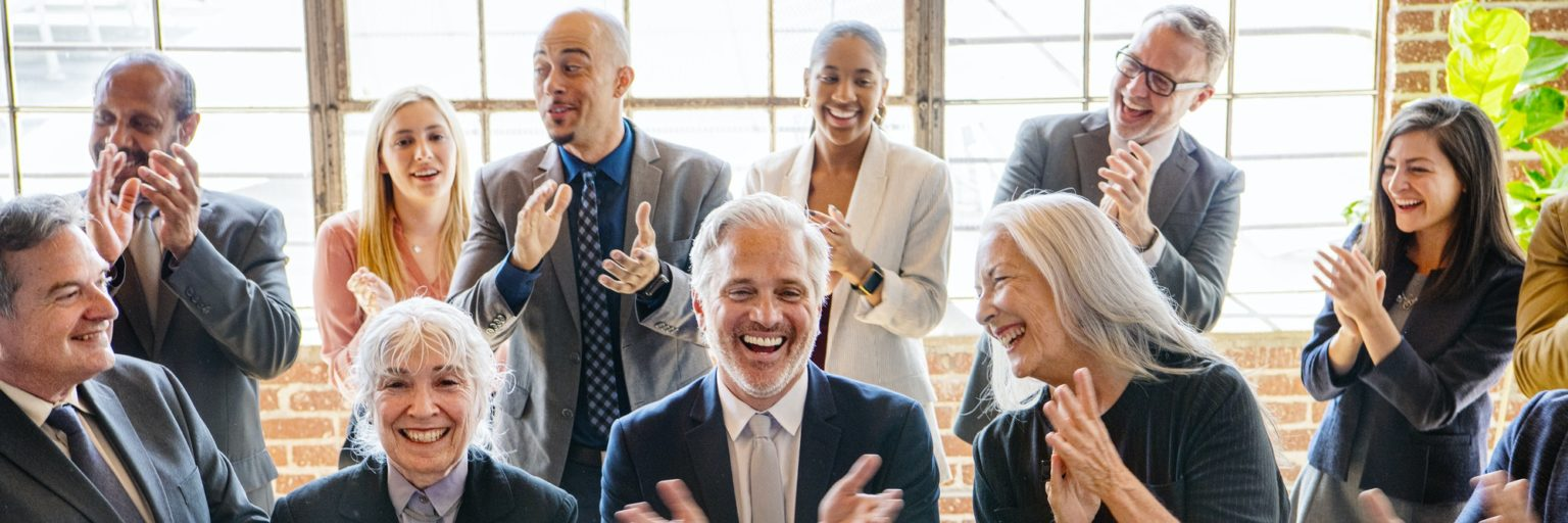 Diverse business people applauding with joy